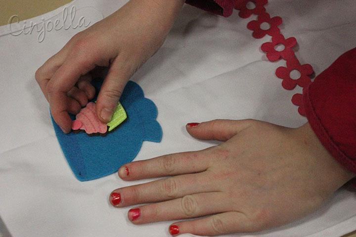 hands putting details on
